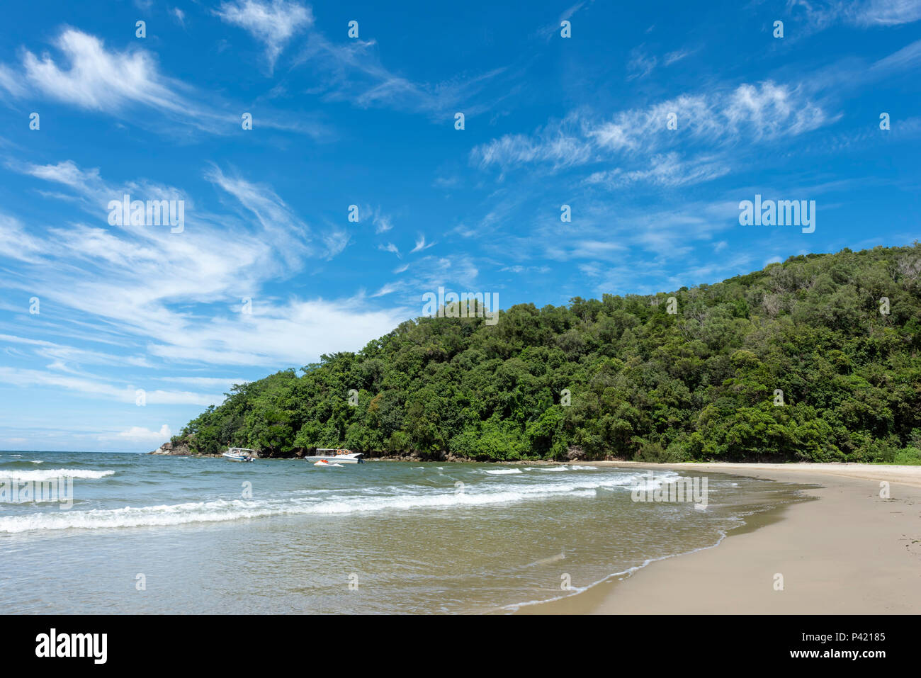 The South China Sea laps the beach in Kota Kinabalu on Borneo, Malaysia - Stock Image