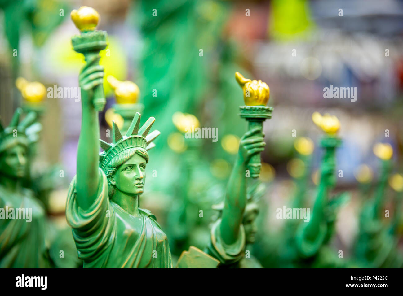 Row with generic Statue of Liberty statues (selective focus) sold as souvenirs in a NYC shop. - Stock Image