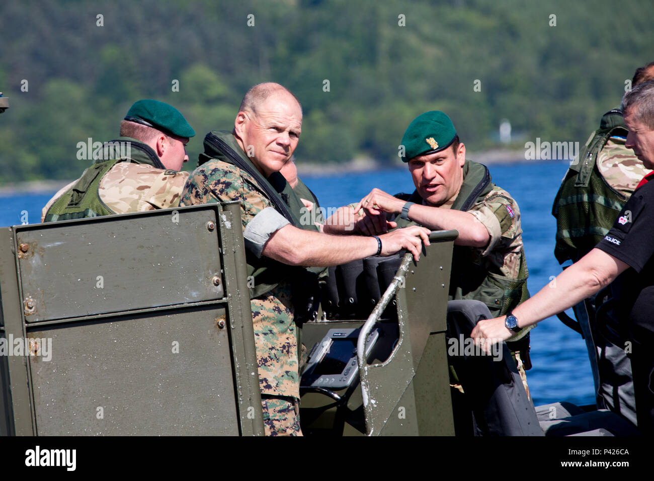 Commandant of the Marine Corps, Gen. Robert B. Neller, center, rides in a offshore raiding craft at Her Majesty's Naval Base, Clyde, Scotland, June 2, 2016. Neller visited the 43 Commando Fleet Protection Group Royal Marines to view their equipment and understand their capabilities. (U.S. Marine Corps photo by Staff Sgt. Gabriela Garcia/Released) - Stock Image