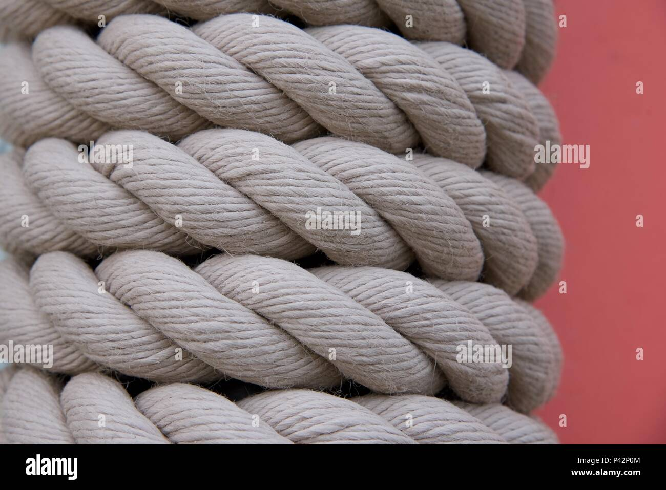Rope: rope coiled around a supporting steel post Stock Photo