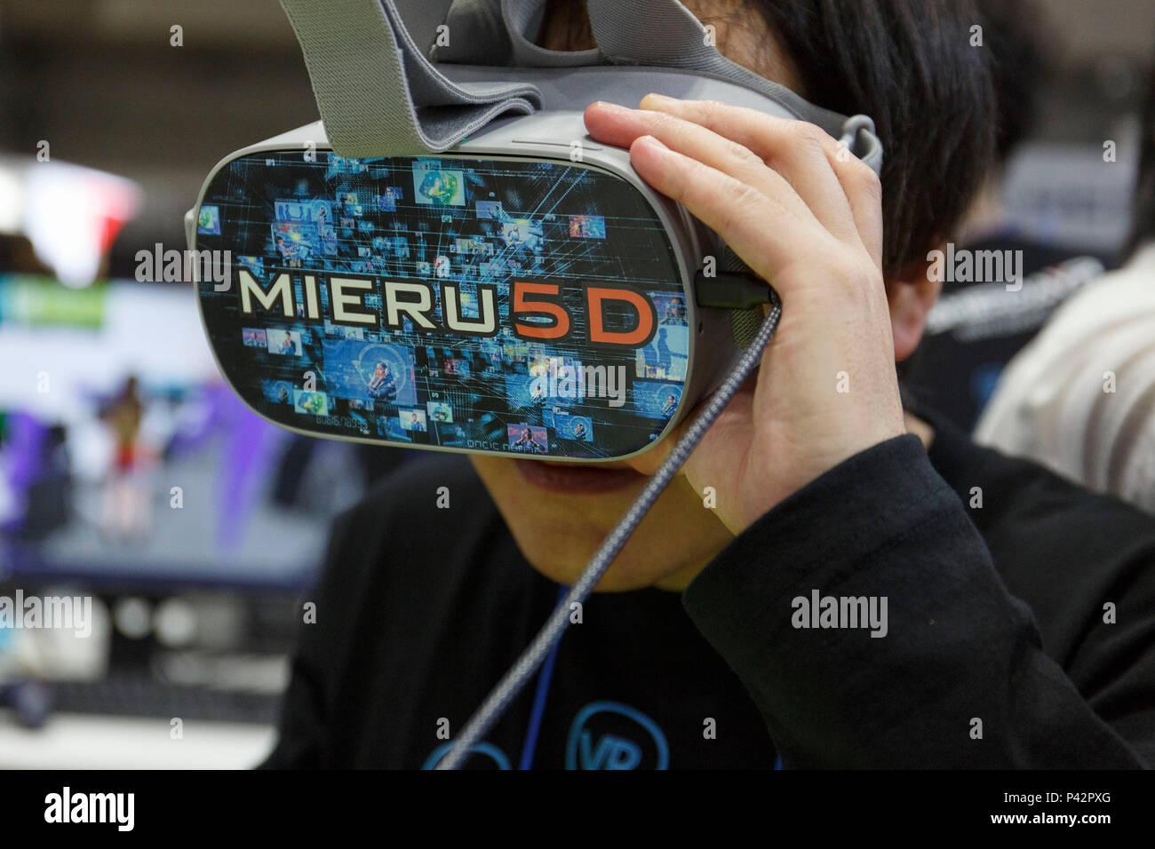 D Virtual Reality Exhibition : Tokyo japan th jun a visitor tests a virtual reality