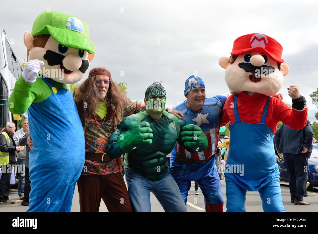 Glasgow, Scotland, UK. 20th, June, 2018. Taxi drivers dressed as cartoon characters at the annual Taxi run taking disabled children on a day trip to Troon in Ayrshire. - Stock Image