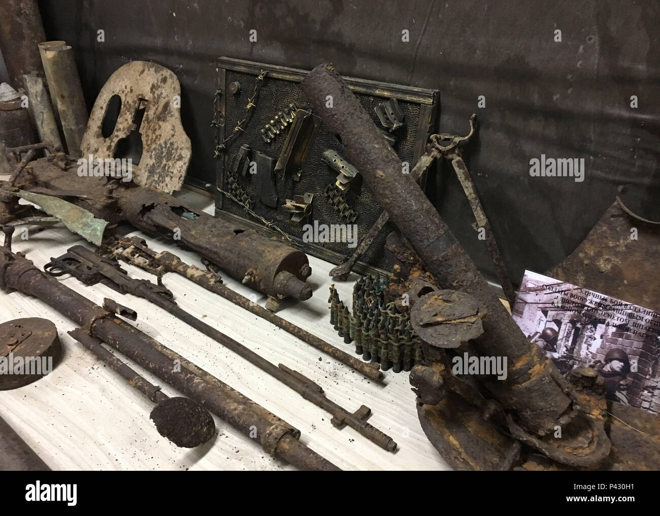 Rossoschka, Russia. 16th June, 2018. Remnants of the Battle of Stalingrad - grenade launchers, cartridges and parts of the weapons - can be seen in a hut in the «Rossoschka Military Cemetery», which houses a small private museum that has been cared for by the 72-year-old Vitaly Danilkin as a caretaker for three years. In the cemetery not only soldiers of the German Wehrmacht are buried, but also members of the Red Army. Credit: Martin Moravec/dpa/Alamy Live News - Stock Image
