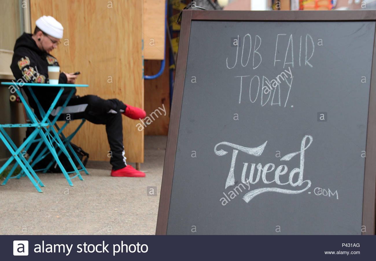 03 June 2018, Canada, St. John's: A sign showing the logo of Canadian cannabis company Tweed stands outside a job fair. The senate has recently decided to legalise cannabis.- NO WIRE SERVICE - Photo: Christina Horsten/dpa - Stock Image