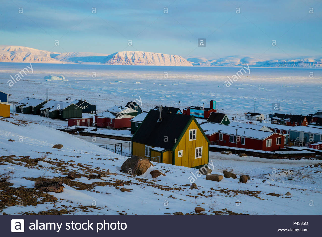 A village on the edge of the sea ice. - Stock Image