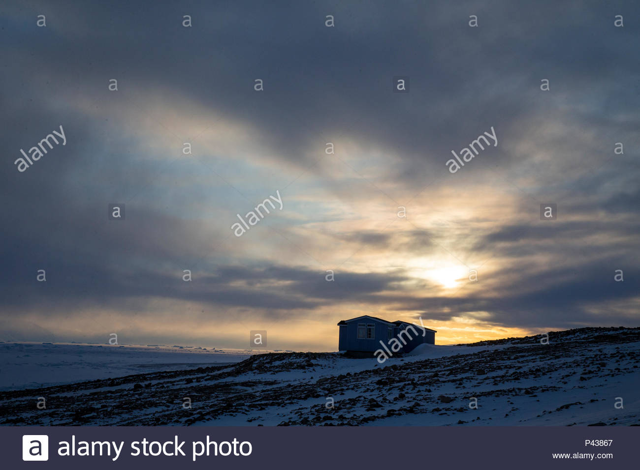 A built structure on the edge of the sea ice. - Stock Image