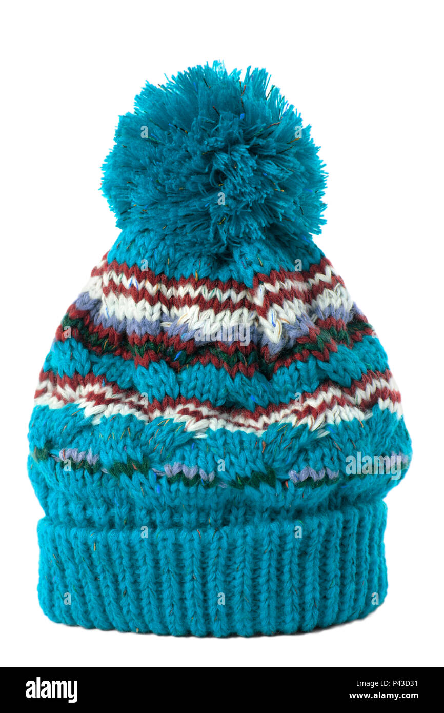 b9208c6a22c Blue knitted bobble hat or ski hat isolated on a white background ...