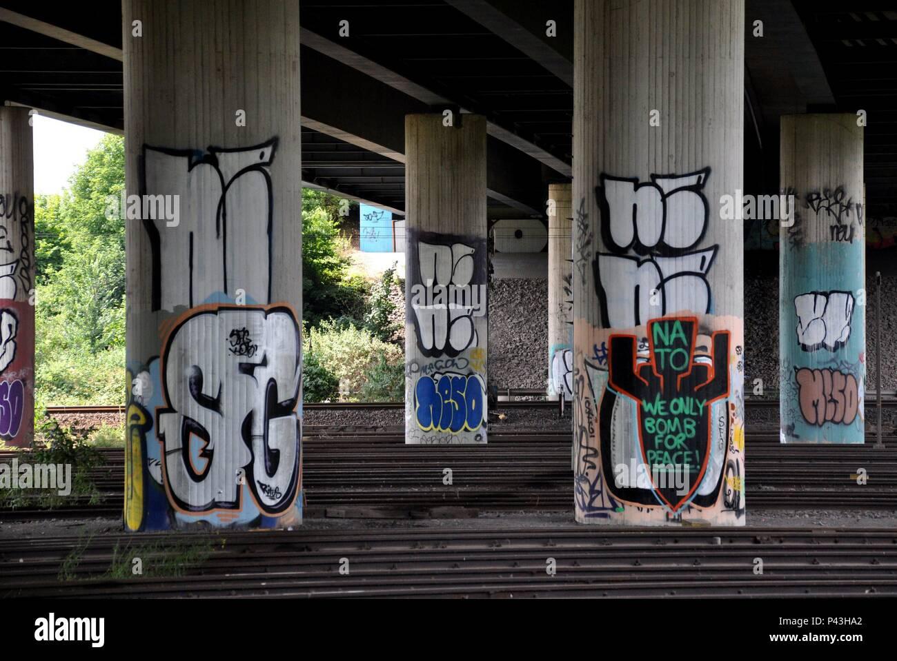 Graffiti 'Nato, we only bomb for peace!' on bridge pier on 05.07.2015 in Dortmund-Huckarde - Germany. | usage worldwide - Stock Image