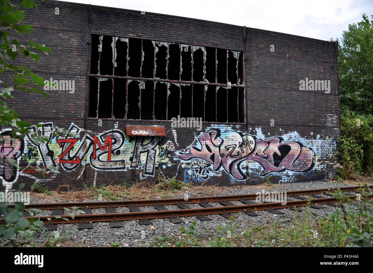 Graffiti on wall of coking plant on 16.09.2016 in Essen - Germany. | usage worldwide - Stock Image