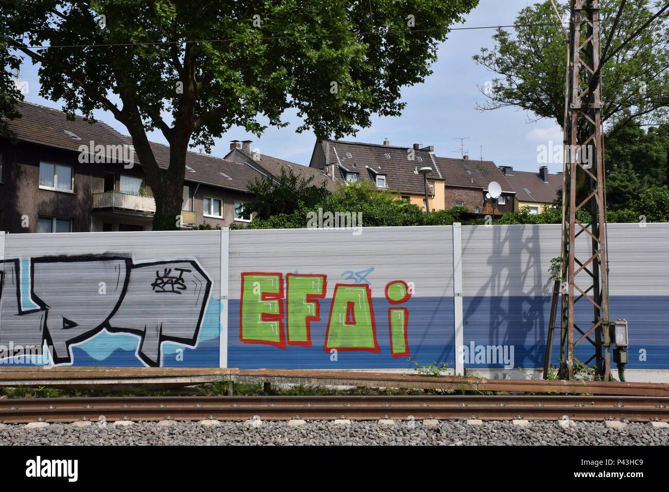 Graffiti on sound barrier at railway line on 08.07.2017 in Bochum-Präsident - Germany. | usage worldwide - Stock Image