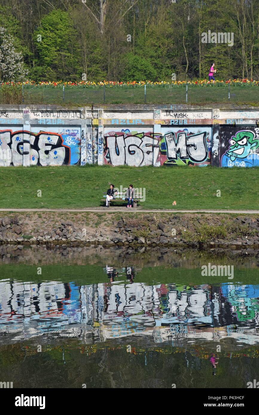 Graffiti on wall near colliery railway and canal on 09.04.2017 in Gelsenkirchen - Germany. | usage worldwide - Stock Image