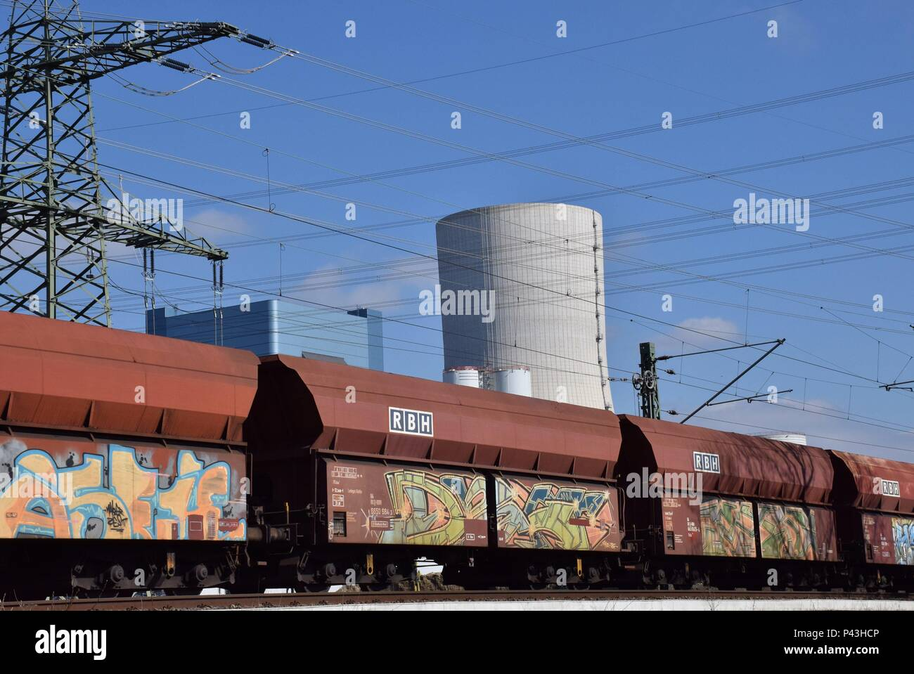 Graffiti on freight waggon in front of power plant on 23.03.2017 in Datteln - Germany. | usage worldwide - Stock Image
