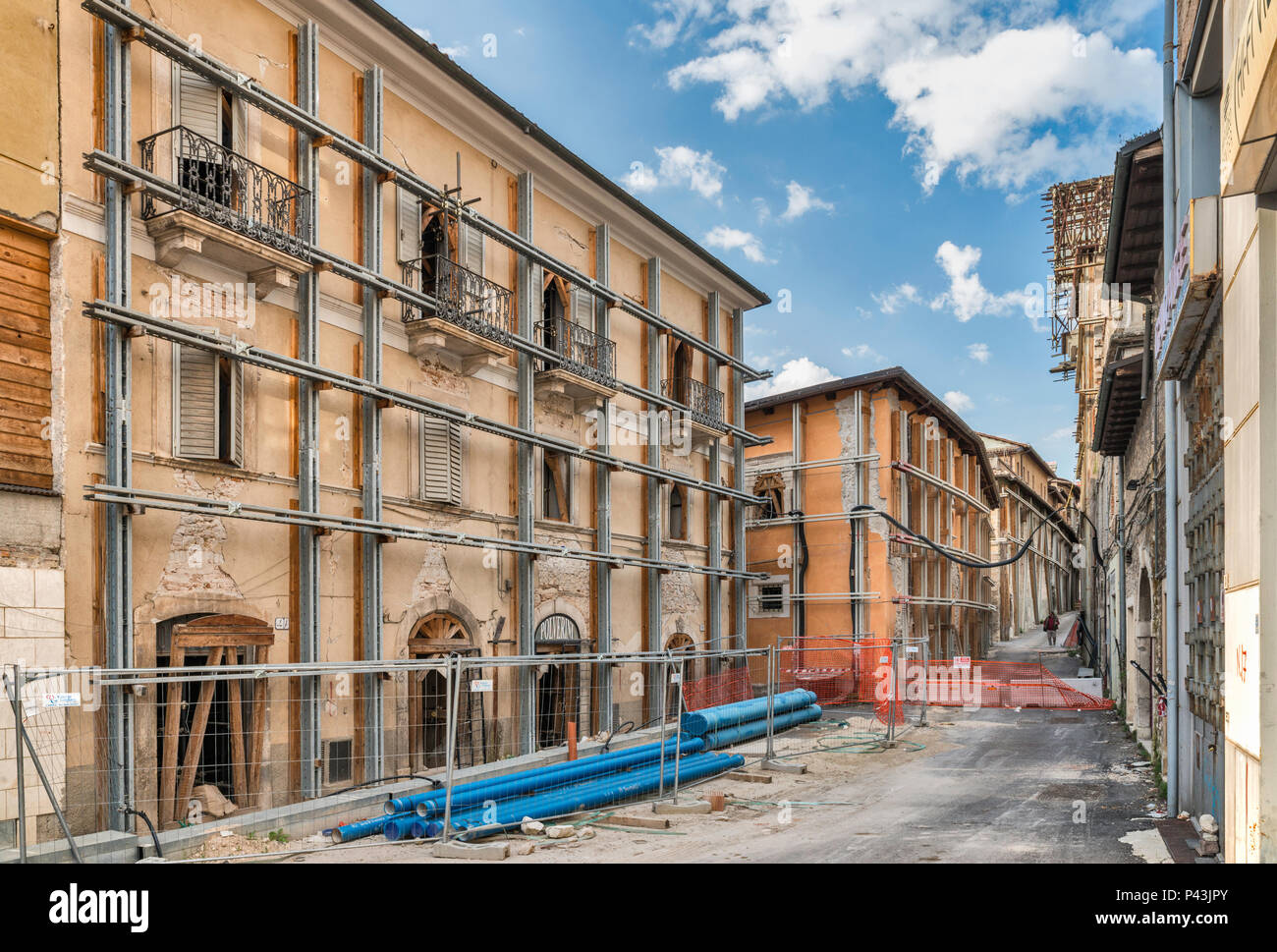 Buildings damaged in 2009 L'Aquila Earthquake, protected by metal beams, 2018 view, Piazza Duomo, L'Aquila, Abruzzo, Italy - Stock Image