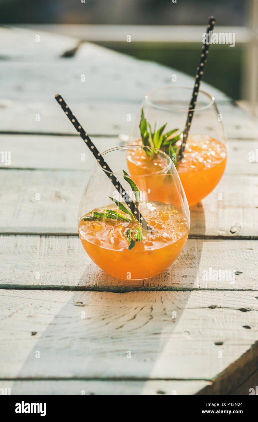 Refreshing cold alcoholic summer citrus cocktail with orange, copy space - Stock Image