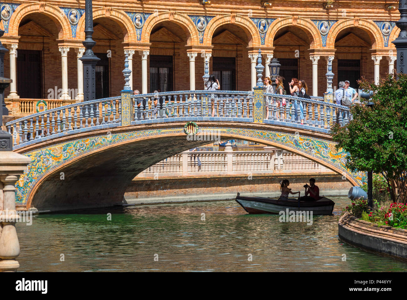 Plaza de Espana Seville, view of a bridge decorated with colorful azulejo tiles spanning a lake in the Plaza de Espana, Sevilla, Andalucia, Spain. - Stock Image