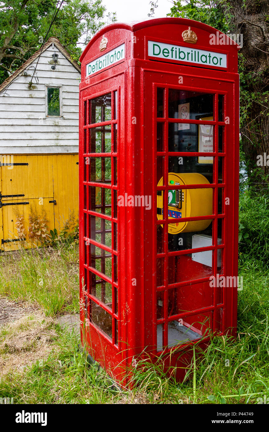 A Public Access Defibrillator Housed In A Telephone Box, High Hurstwood, Sussex, UK - Stock Image
