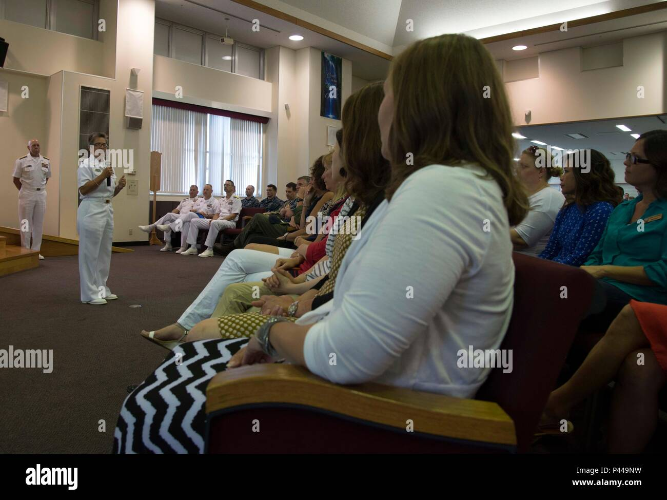 SASEBO, Japan (June 13, 2016) U.S. Pacific Fleet Master Chief Susan Whitman speaks with service members and civilians during a town hall held at Commander, U.S.  Fleet Activities Sasebo, June 13, 2016. Commander, U.S. Pacific Fleet Adm. Scott H. Swift was the primary speaker at the event. Swift visited Sasebo to meet with area servicemembers and civilians to to strengthen relations with Japan Self-Defense Force personnel as the two nations work toward a safe, secure and prosperous region. (U.S. Navy photo by Mass Communication Specialist 1st Class David R. Krigbaum/Released) - Stock Image