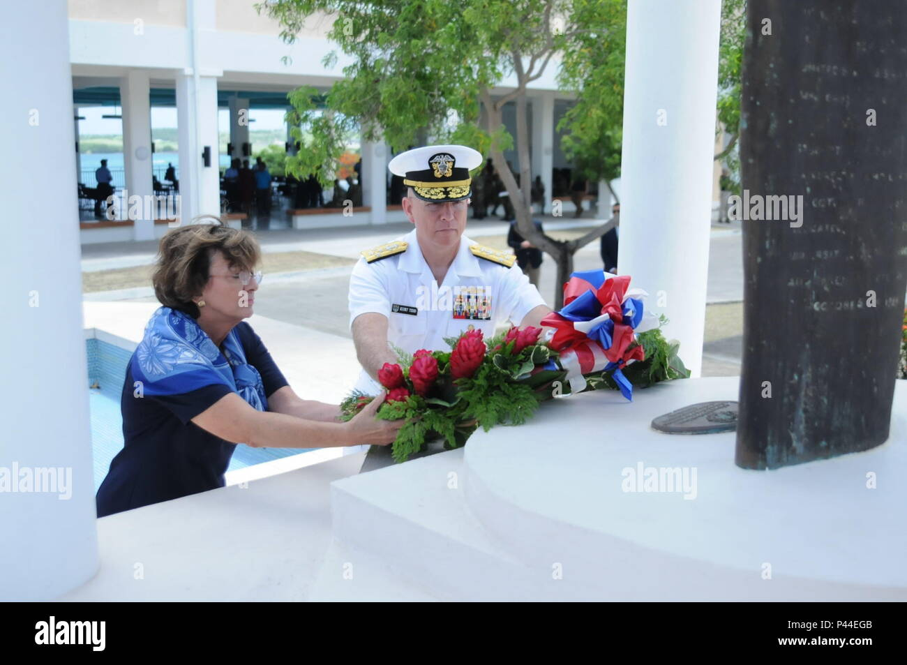 Linda S. Taglialatela, Chief of the U.S. Mission to Barbados, the Eastern Caribbean and the OECS, and Adm. Kurt W. Tidd, commander of U.S. Southern Command, lay a wreath at the base of a monument on the campus of St. George's University in Grenada, June 14, 2016. The monument memorializes the U.S. servicemen killed during Operation Urgent Fury in 1983. The laying of the wreath took place after the closing ceremony for Tradewinds 2016.  U.S. Army photo by Sgt. Jason Drager. - Stock Image