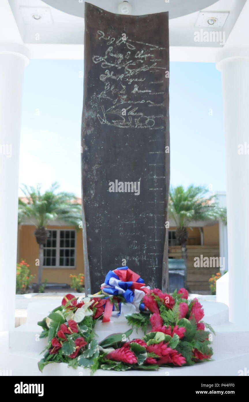 A wreath lays at the base of a monument on the campus of St. George's University in Grenada, June 14, 2016. The monument memorializes the U.S. servicemen killed during Operation Urgent Fury in 1983. The laying of the wreath took place after the closing ceremony for Tradewinds 2016.  U.S. Army photo by Sgt. Jason Drager. - Stock Image