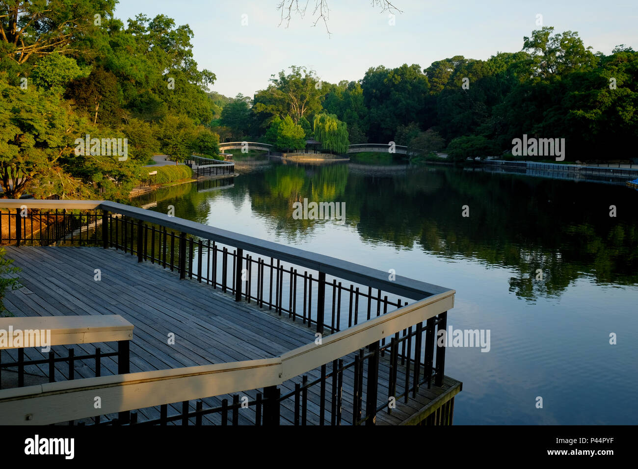 View from the observation deck of the lake at Pullen Park in downtown Raleigh North Carolina in the early morning sunshine - Stock Image