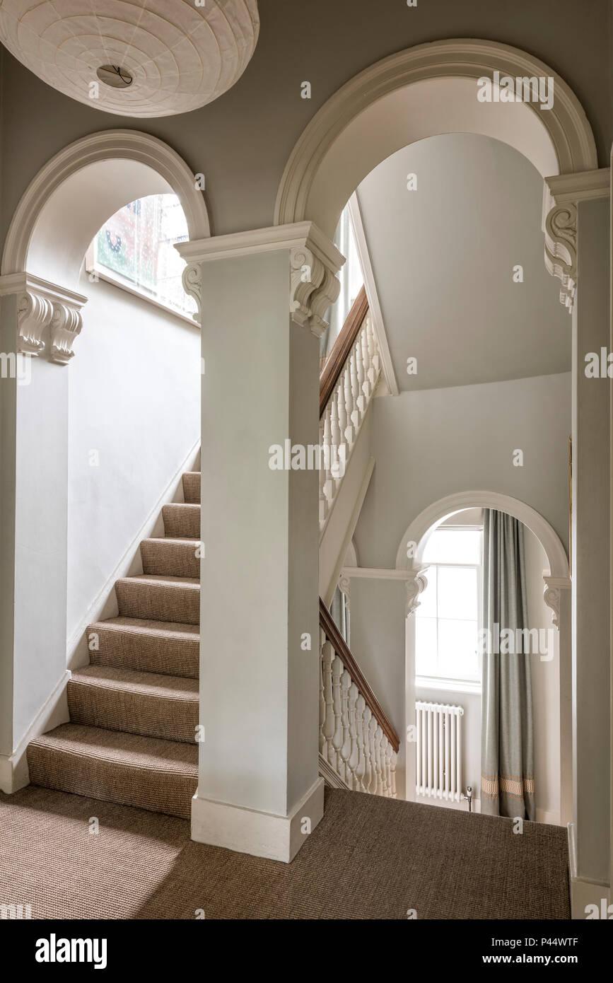 Elegant Victorian arches in stairway Stock Photo