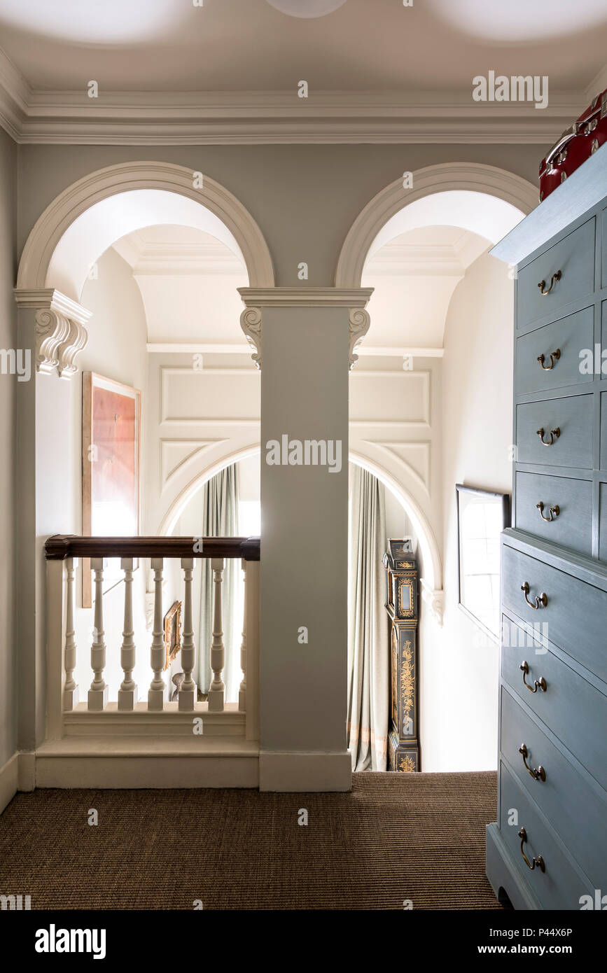 Large blue storage drawers on landing in Victorian home - Stock Image