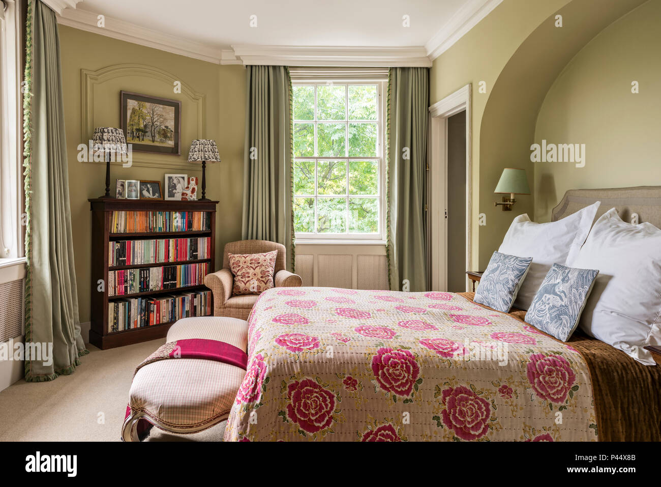 Pink floral quilted cover on bed in Victorian home with vintage ...
