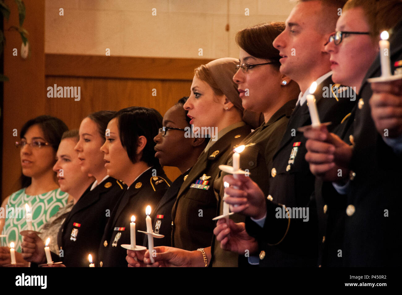 U.S. Army Soldiers and Egyptian army officers from Class 15-155 recite the Nightingale Pledge during the William Beaumont Army Medical Center Phase II Practical Nurse Course graduation ceremony at Hope Chapel, Fort Bliss, June 21. - Stock Image
