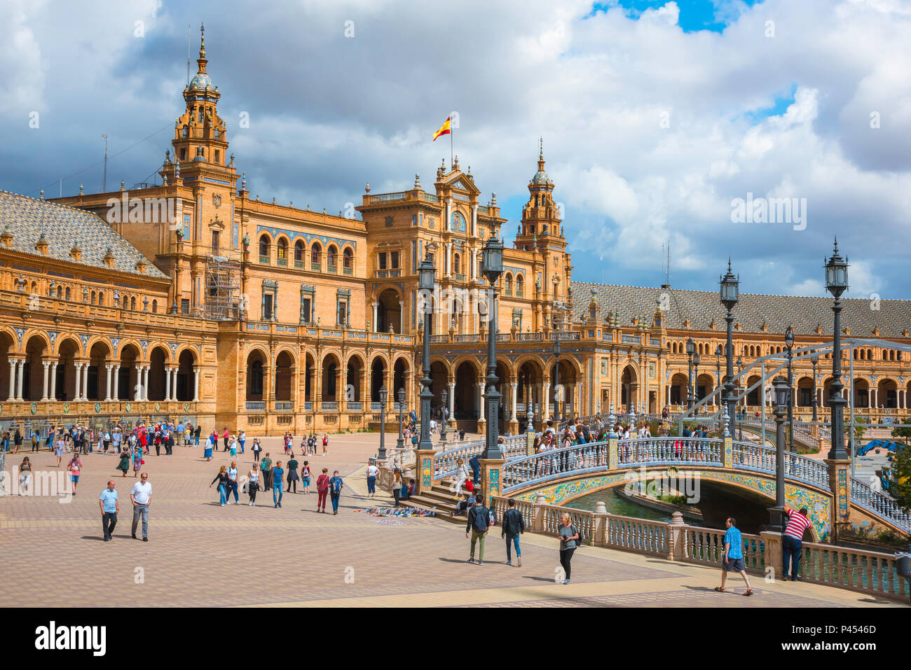 Plaza de Espana Seville, view of people walking through the historic Plaza de Espana in Seville (Sevilla) on a summer afternoon, Andalucia, Spain. Stock Photo