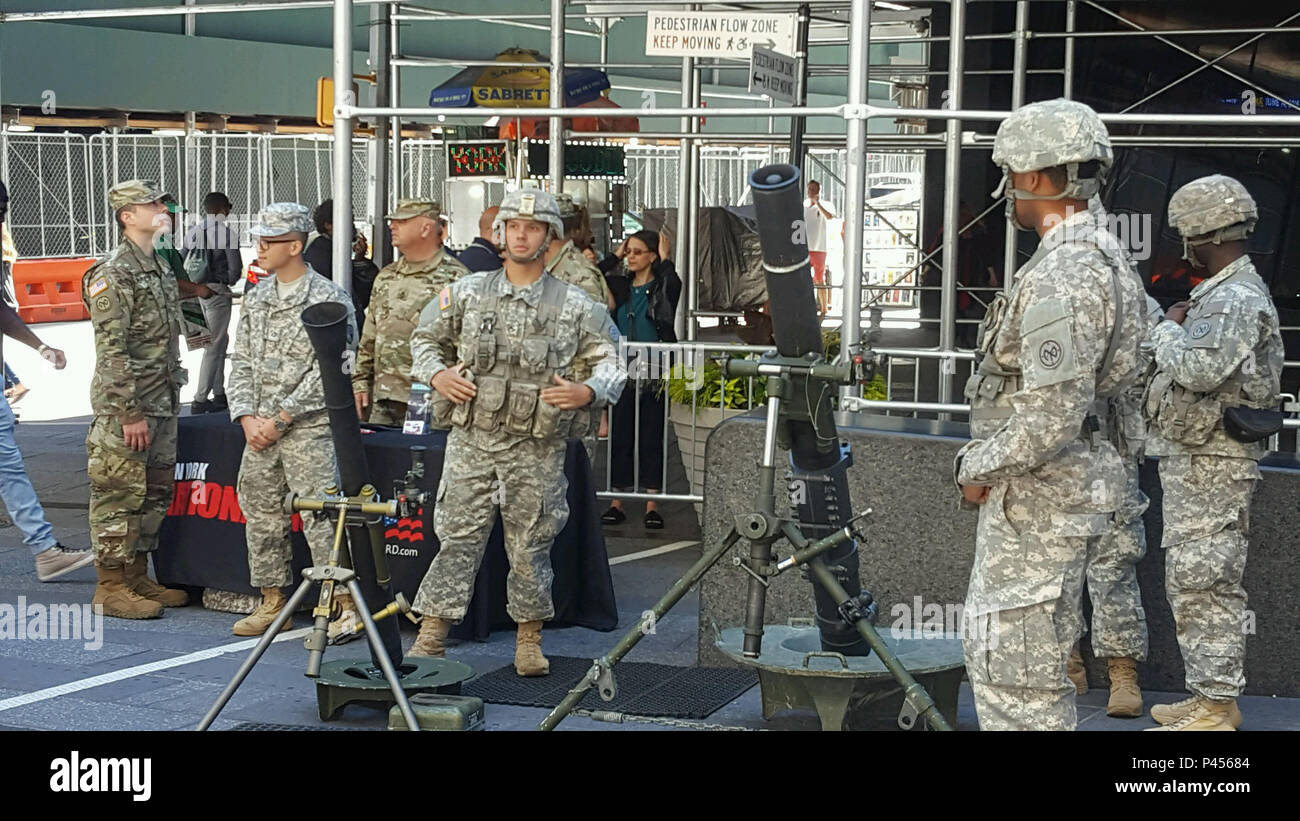 Members of the 1st Battalion 69th Infantry speak with members of the public during an Army Birthday event held on Tuesday, June 14, 2016 in New York's Times Square. The New York Army National Guard infantry battalion supported the Military District of Washington event with equipment and Soldiers in battle gear. ( U.S. Army National Guard photo by Capt. Gavin McDermott/Released) Stock Photo