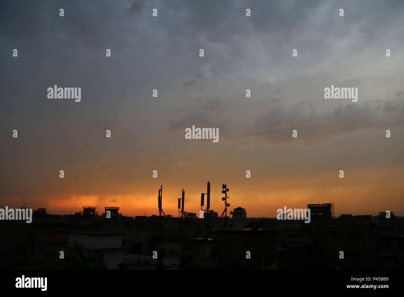 The evening sky of the city of Dhaka - Stock Image
