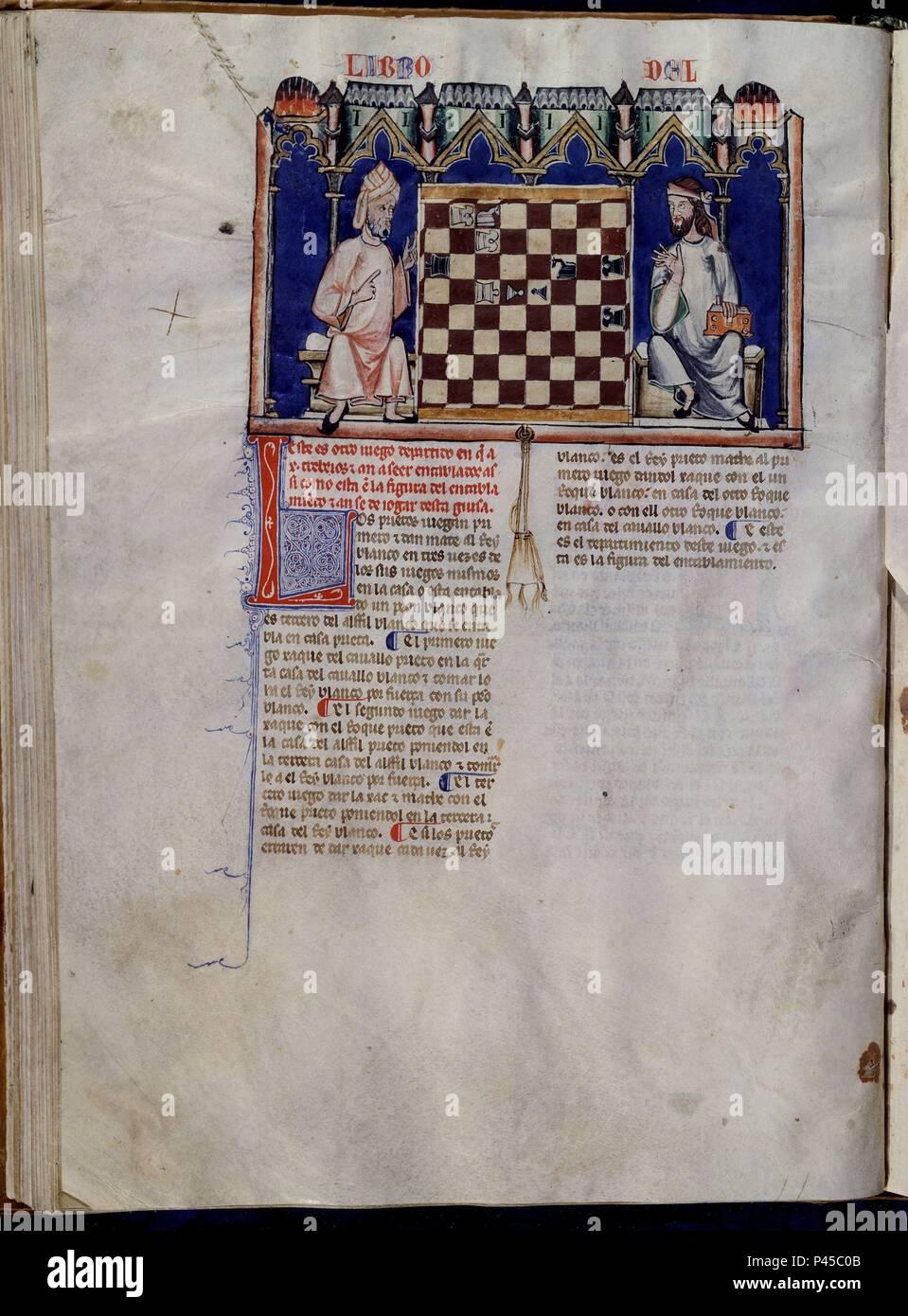 LIBRO DE JUEGOS O LIBRO DEL AJEDREZ DADOS Y TABLAS - 1283 - FOLIO 42V - DOS HOMBRES JUGANDO AL AJEDREZ - MANUSCRITO GOTICO. Author: Alfonso X of Castile the Wise (1221-1284). Location: MONASTERIO-BIBLIOTECA-COLECCION, SAN LORENZO DEL ESCORIAL, MADRID, SPAIN. - Stock Image