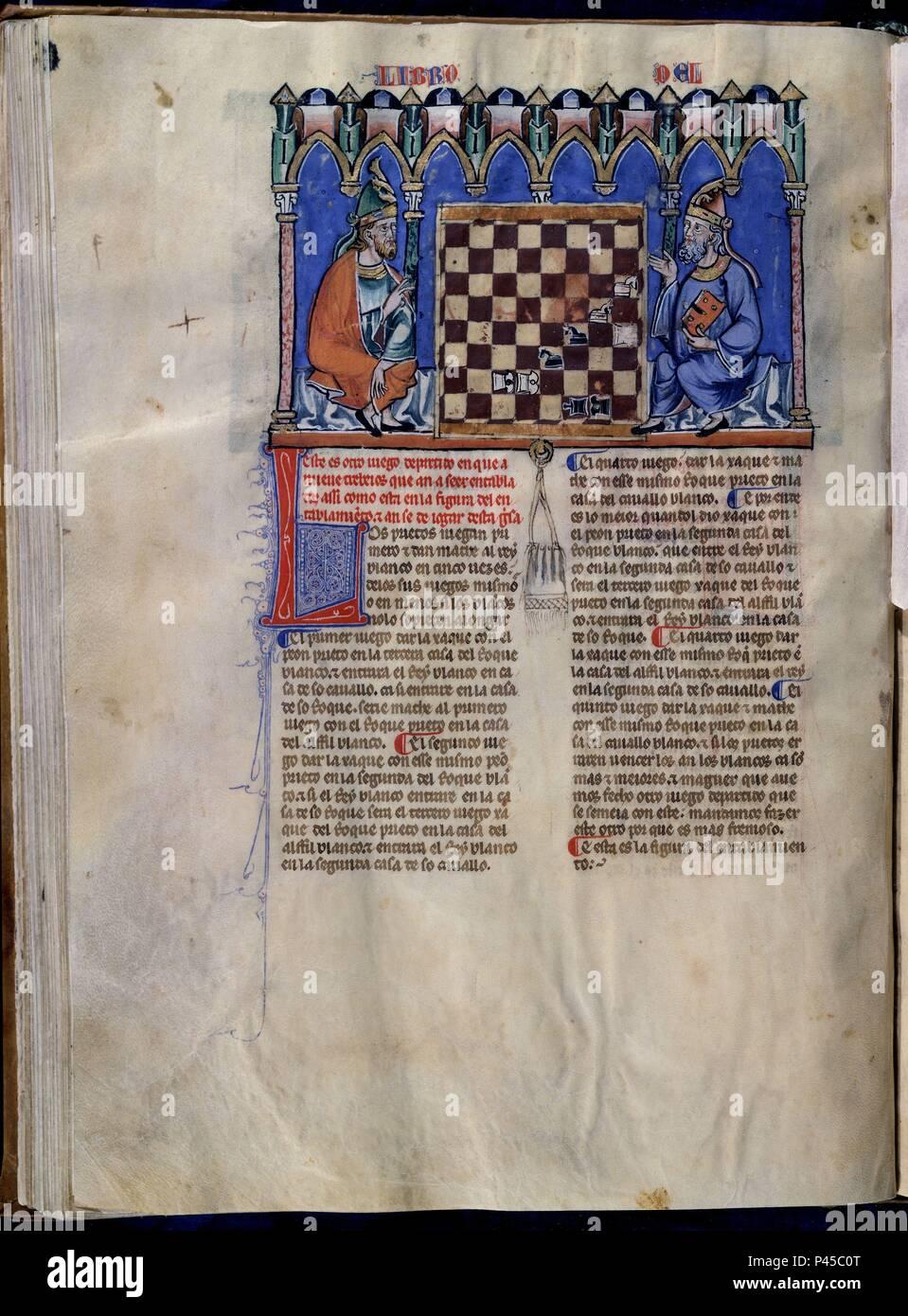 LIBRO DE JUEGOS O LIBRO DEL AJEDREZ DADOS Y TABLAS - 1283 - FOLIO 43V - DOS HOMBRES JUGANDO AL AJEDREZ - MANUSCRITO GOTICO. Author: Alfonso X of Castile the Wise (1221-1284). Location: MONASTERIO-BIBLIOTECA-COLECCION, SAN LORENZO DEL ESCORIAL, MADRID, SPAIN. - Stock Image