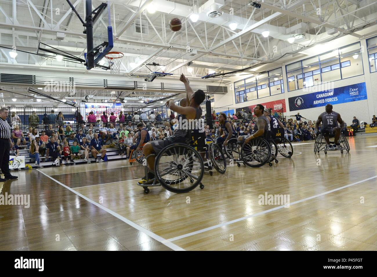 Army Spc, June 4, 2018. Vairon Caicedo Ocampo from Team SOCOM takes a shot against Navy in the wheelchair basketball game during the 2018 Warrior Games held at the Air Force Academy in Colorado Springs June 4, 2018. Several members of Team SOCOM advanced to the finals. Created in 2010, the DoD Warrior Games introduce wounded, ill and injured service members and veterans to Paralympic-style sports. Warrior Games showcases the resilient spirit of today's wounded, ill or injured service members from all branches of the military. These athletes have overcome significant physical and behavioral inj - Stock Image