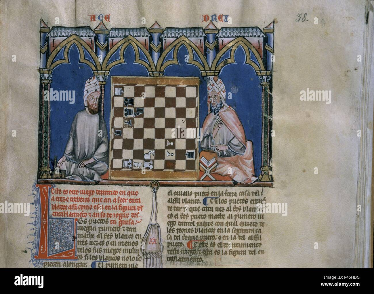 LIBRO DE JUEGOS O LIBRO DEL AJEDREZ DADOS Y TABLAS - 1283 - FOLIO 38R - DETALLE - DOS ARABES CON UN LIBRO JUGANDO AL AJEDREZ - Conj nº 90059. Author: Alfonso X of Castile the Wise (1221-1284). Location: MONASTERIO-BIBLIOTECA-COLECCION, SAN LORENZO DEL ESCORIAL, MADRID, SPAIN. Stock Photo