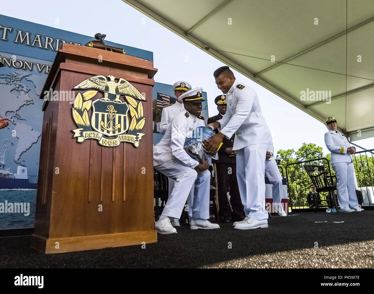 Ensign Kelvin Henley, of Smithfield, Virginia, receives his