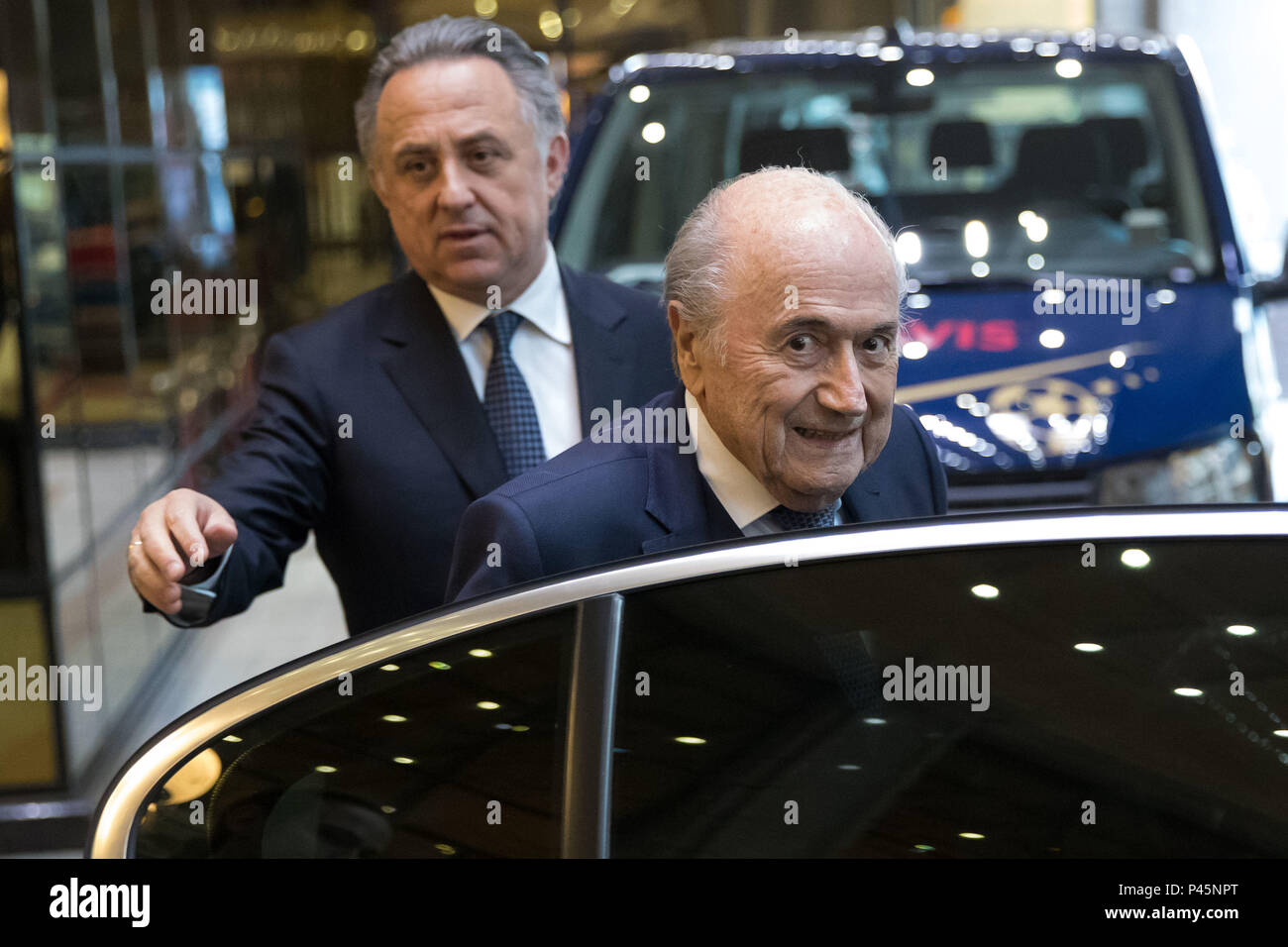 Vitaly Leontiyevich Mutko Deputy Prime Minister of Russia and former FIFA president Joseph 'Sepp' Blatter exit The St Regis Hotel together in Moscow. - Stock Image