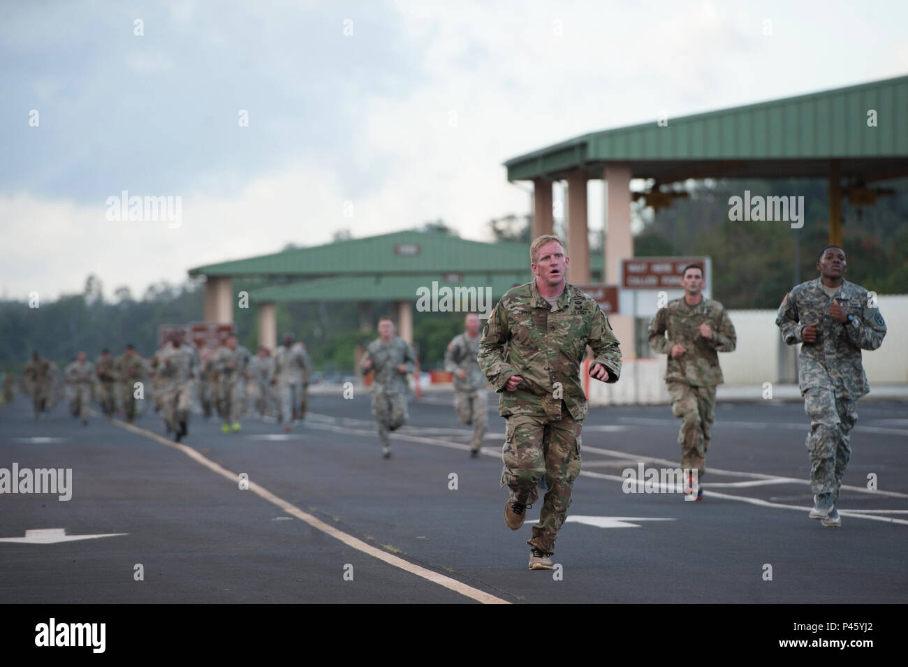 Soldiers approach the finish line of a two mile run as part