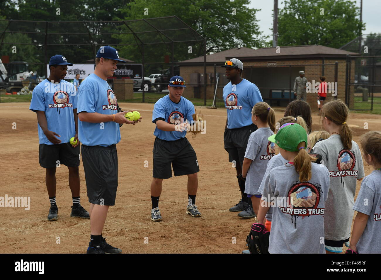 Collegiate baseball players teach pitching and catching