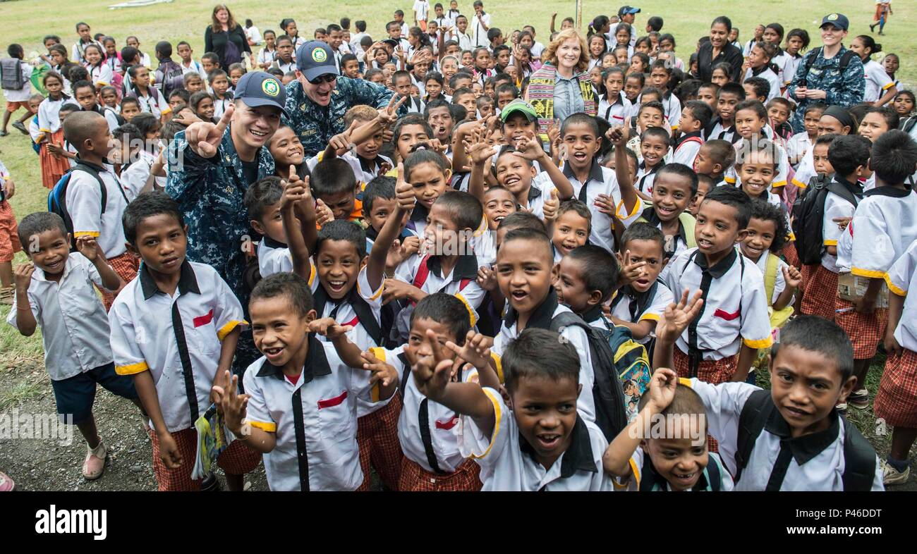 160614-N-QW941-029 DILI, Timor Leste (June 14, 2016) Personnel assigned to USNS Mercy (T-AH 19) pose for a photo with the U.S. Ambassador of Timor Leste, Karen Stanton, and the students of Escola Basica Filial Dona Ana Lemos. Mercy is currently in Timor Leste supporting Pacific Partnership 2016. This year marks the sixth time the mission visited Timor Leste since its first visit in 2006. Medical, engineering and various other personnel embarked aboard Mercy are working side-by-side with partner nation counterparts, exchanging ideas, building best practices and relationships to ensure preparedn Stock Photo