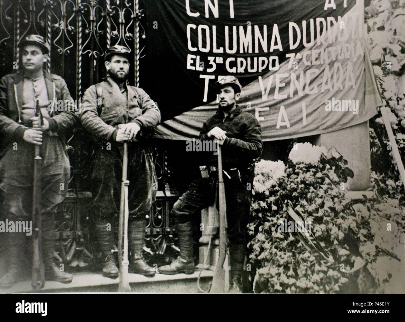 Spanish Civil War (1936-1939). Men with a CNT Flag. Hombres con bandera de la CNT. Civil War 1936. - Stock Image