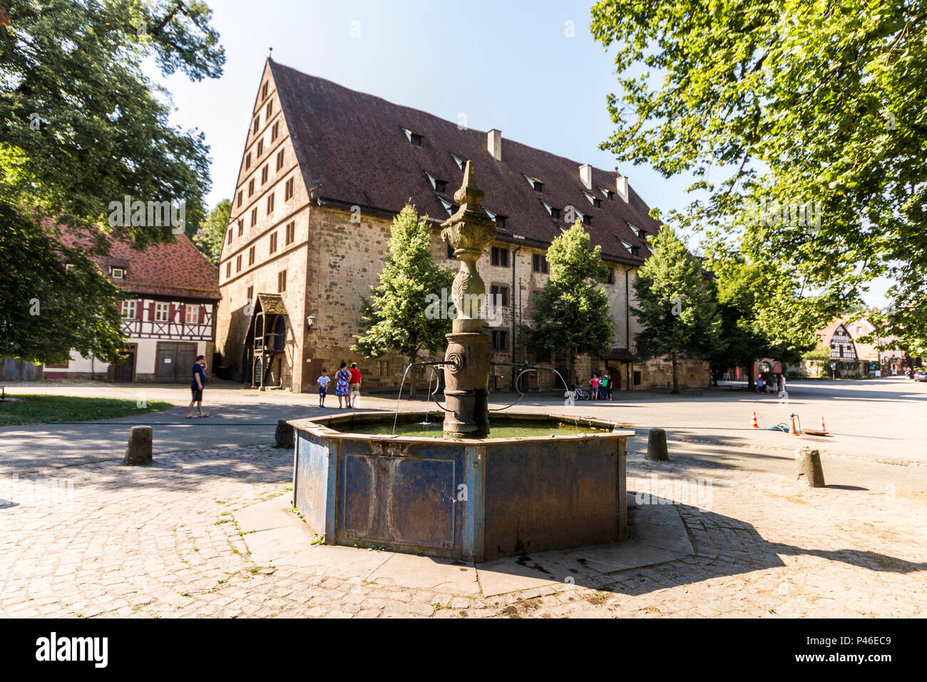 Maulbronn, Germany. Fountain and one of the buildings of Maulbronn Monastery complex (Kloster Maulbronn). A World Heritage Site since 1993 Stock Photo