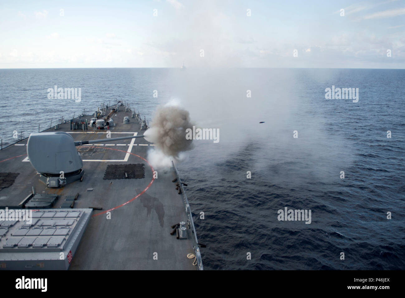 160630-N-XG464-278 ATLANTIC OCEAN (June 30, 2016) The Arleigh Burke-class guided-missile destroyer USS Cole (DDG 67) fires a MK 45 5-inch gun during a live-fire exercise. Cole is conducting routine training and operations in preparation for its upcoming deployment with the George H.W. Bush Strike Group. (U.S. Navy photo by Mass Communication Specialist 2nd Class Jonathan B. Trejo/Released) - Stock Image