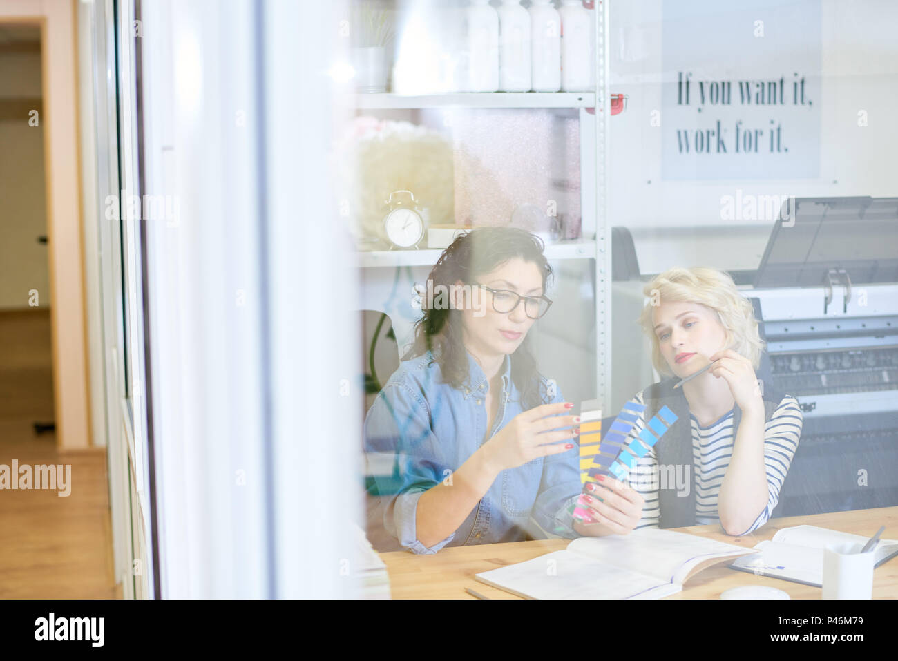 Women selecting color for project - Stock Image