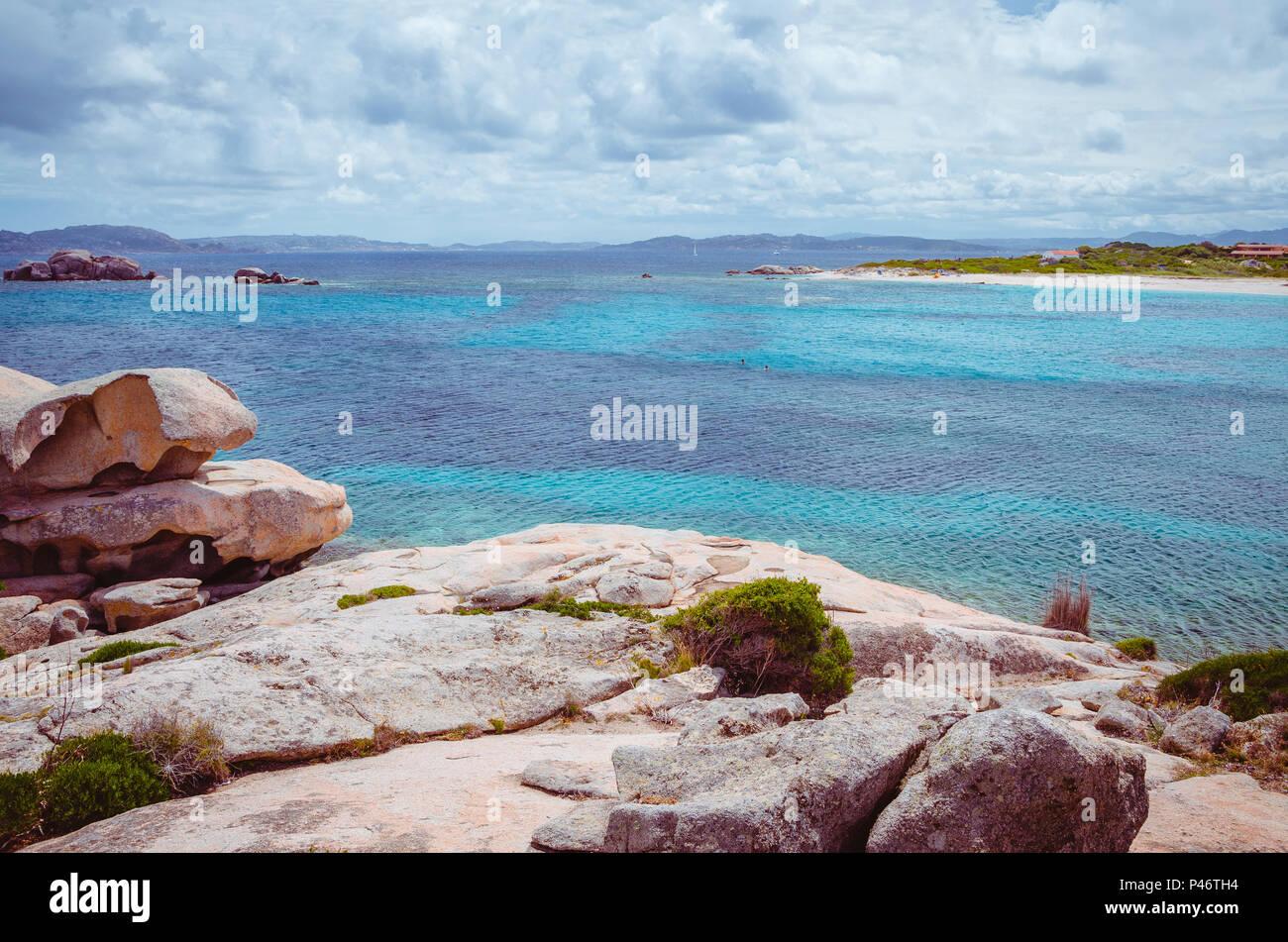 Bizarre granite rocks formation and clear azure sea on beautiful Sardinia island, Sargedna, Italy - Stock Image