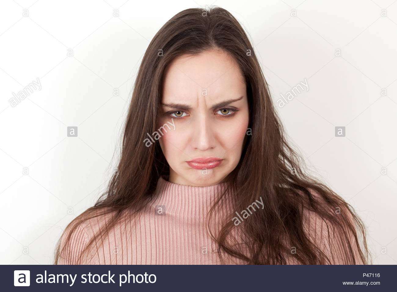 Scowling woman with upset face expression - Stock Image