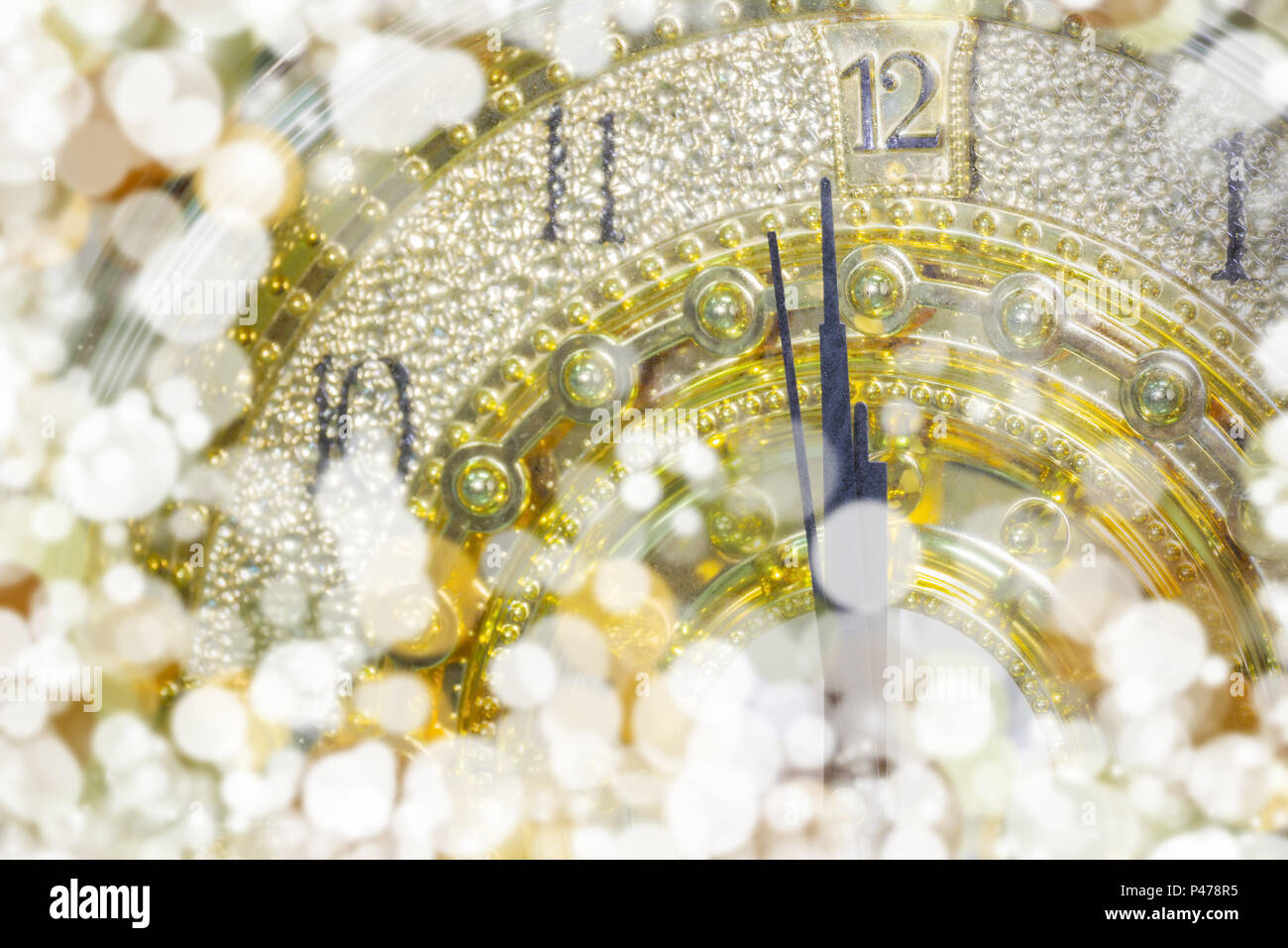 New Year's at midnight time, Luxury gold clock countdown to new year, effect light. Stock Photo