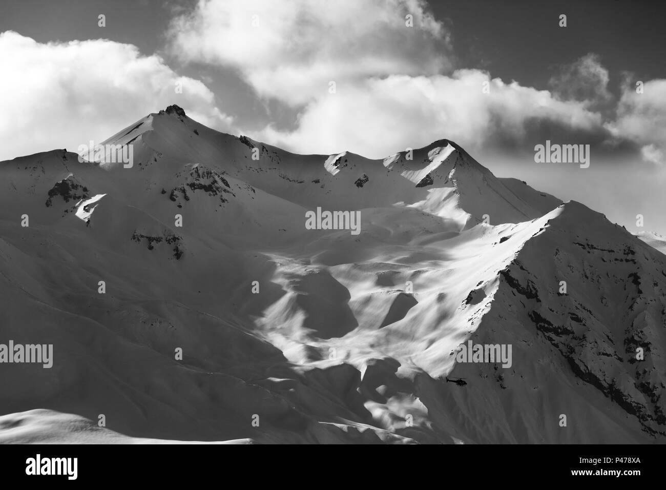 Black and white off piste slope for heliskiing in evening. Region Gudauri, Caucasus Mountains, Georgia in winter. - Stock Image