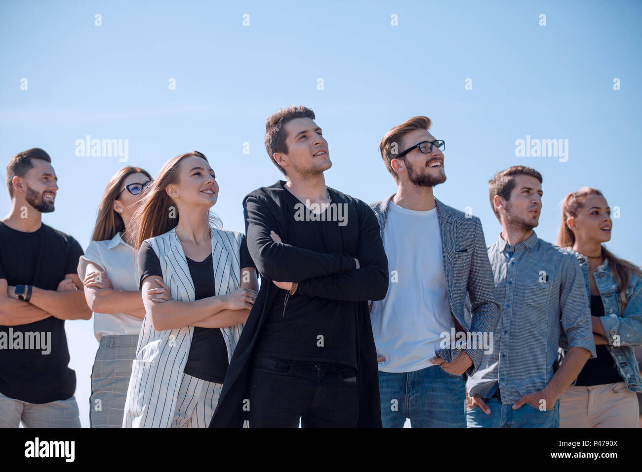 group of successful youth looking at a copy space - Stock Image