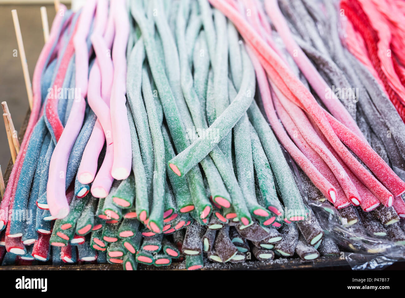 Candy sticks in any color and appearance - Stock Image